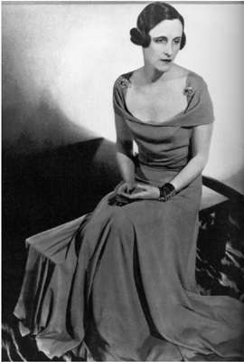 "photograph of Sophie Gimbel (AKA ""Sophie of Saks"") wearing a coral crepe Vionnet dress, 1933. Sophie was married to Adam Gimbel, owner of the department store Saks Fifth Avenue, NY"